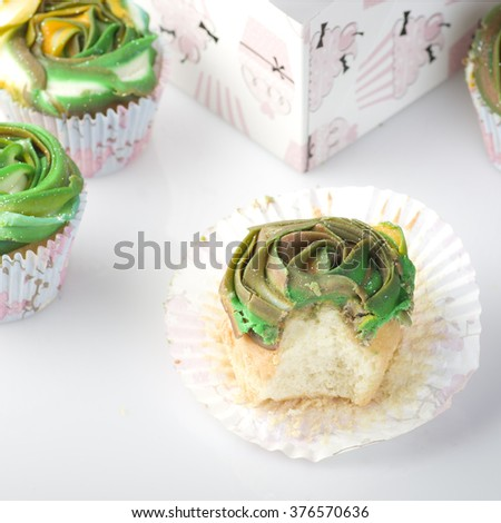 Home baked tasty cup cakes, muffins with frosting on top isolated on white background.
