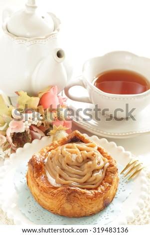 Home bakery, marron chestnut cream Danish pastry with tea - stock photo