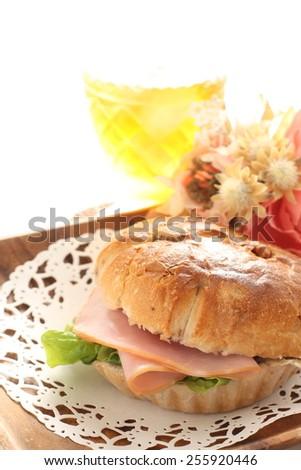 home bakery, walnut and raisin ham sandwich with iced tea on background - stock photo