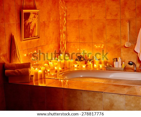 Home bathroom interior with bubble bath. Burning candels. - stock photo