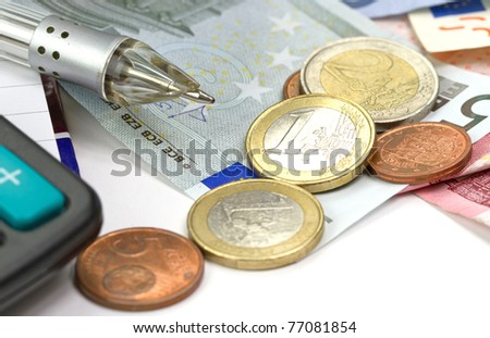 Home budget counting with calculator and pen - stock photo