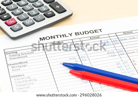 Home budget planning sheet with pen and calculator - stock photo