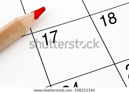 home calendar with dates and red sharpened pencil - stock photo