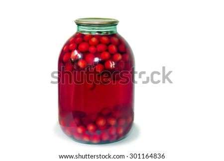 Home canning: a large glass cylinder with cherry compote, sealed metal lid. Presented on a white background.. - stock photo