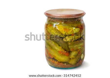 Home canning: a small glass cylinder with canned (breathlng heavlly) with carrots, cucumbers, sealed metal lid. Presented on a white background.. - stock photo