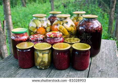 Home canning. Pickled vegetables and jam - stock photo