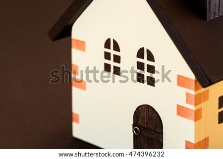 Home concept.  Colorful  wooden model of house.