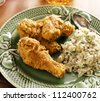 home cooked fried chicken meal cilantro lime quinoa side dish. - stock photo