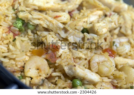 home cooked paella with chicken and seafood - stock photo