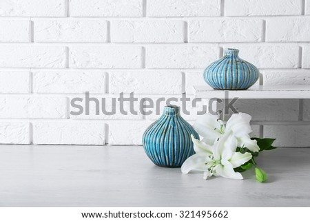 Home decor and flowers on brick wall background - stock photo