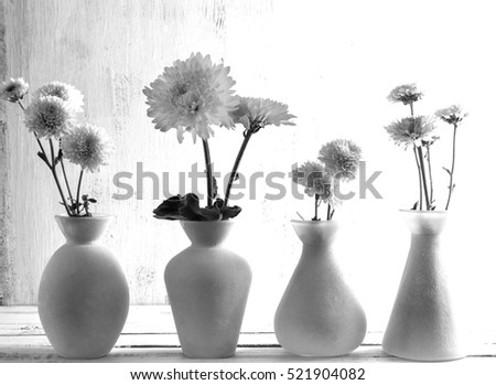Home Decor from vases. Black and white photography. Vases with flowers. Interior.