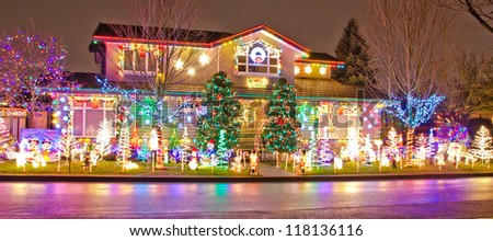 Home decorated and lighted for Christmas and for New Year Eve at Night at Vancouver, Canada. - stock photo