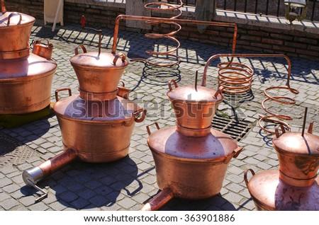 Home distilleries on Gypsy market in Romania - stock photo