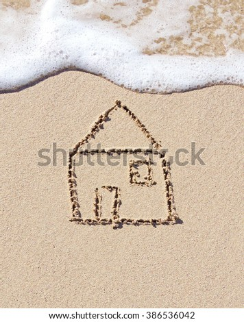 Home, drawing in the sand and surf - stock photo