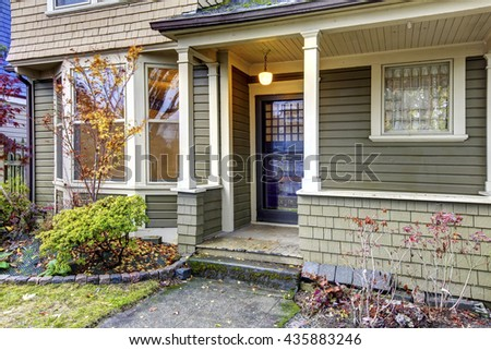 Home exterior with small porch - stock photo