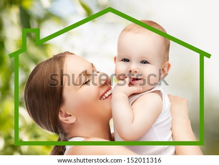 home, family and environment - happy mother with adorable baby and eco house - stock photo