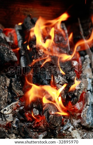 Home fireplace. Red fire and black ash abstract background - stock photo