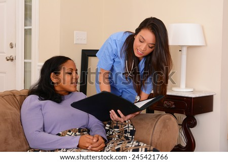 Home health care worker and an adult woman - stock photo