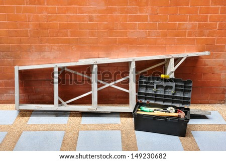 Home improvement concept with ladder and toolbox - stock photo