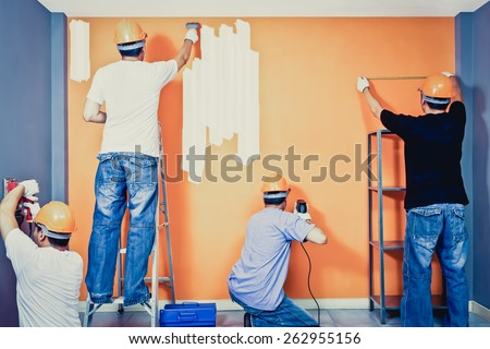 Home improvement, Renovation set. asian craftsman team working in the room, art filter - stock photo