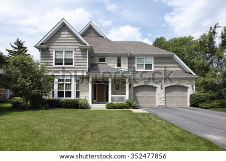 Home in suburbs with double garage - stock photo