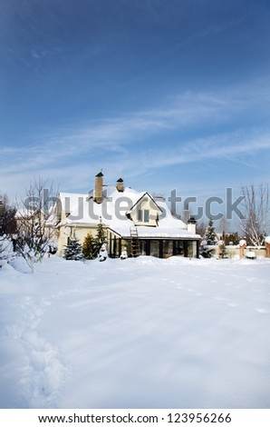 home in winter - stock photo