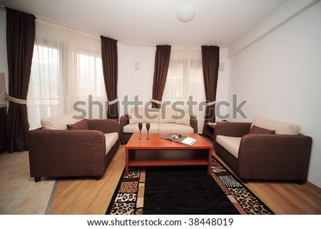 Home interior living room with table and sofa - stock photo