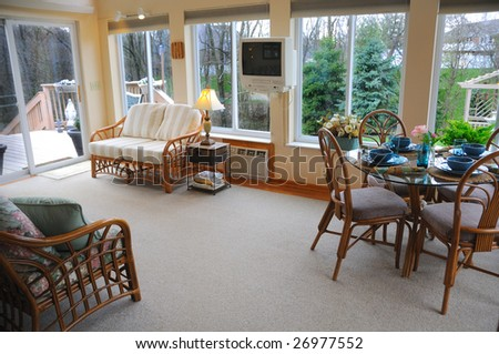 Home Interior shot of a sun room in a modern American house. - stock photo