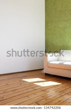 home interior, view parquet and white sofa, detail - stock photo