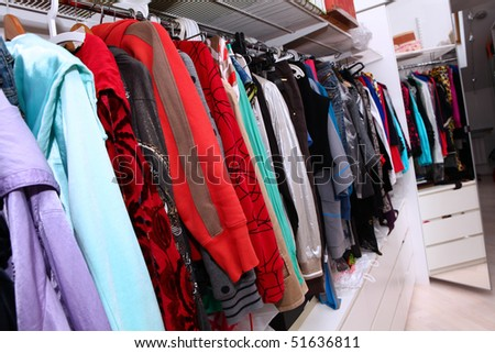 Home interior with female clothing hanging on - stock photo