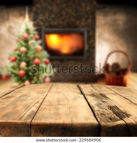 home interior with old big table and red balls on green tree of xmas  - stock photo