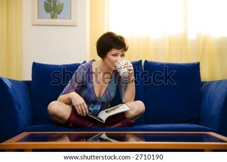 home life: girl reading a magazine  at home - stock photo