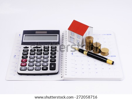 Home Loans Concept With Calculator And Fountain Pen Paper House Money Coins Stack On