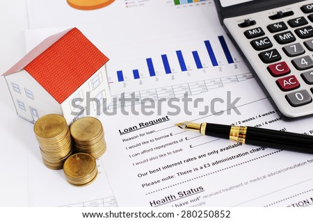 Home loans concept with close up fountain pen and loans request form and coins stack and paper house and calculate - stock photo