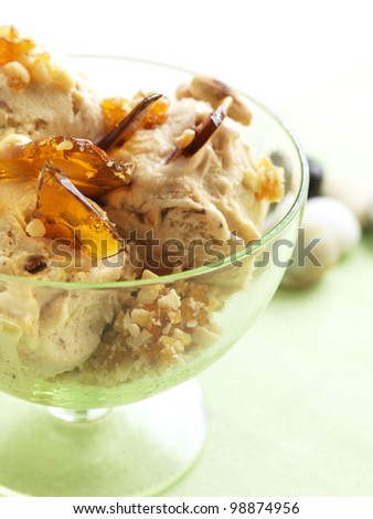 home made almond ice cream with caramel pieces - stock photo