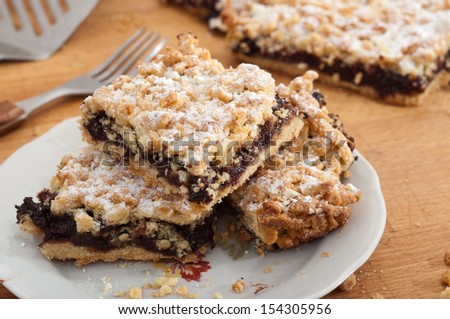 Home-made apple pie from plum jam with chocolate and with crumble topping - stock photo