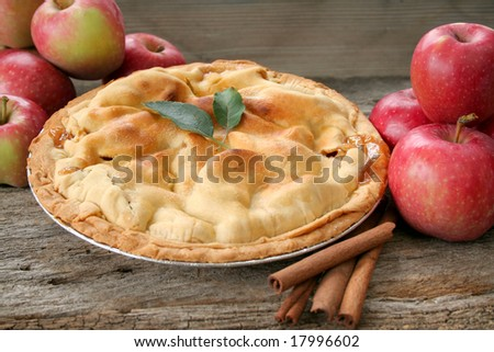 Home made apple pie with fresh apples and cinnamon sticks. - stock photo