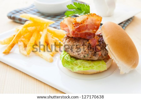 home made bacon burger whit french fries on tray