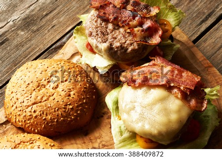 Home made cheeseburgers on rustic wooden table - stock photo
