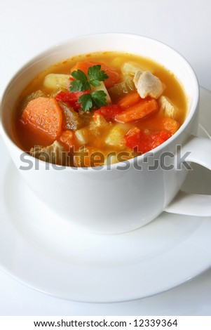 Home-made chicken and vegetable soup, in a white soup cup. - stock photo