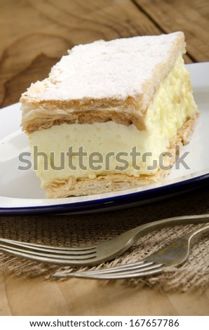 home made custard cake on a plate - stock photo