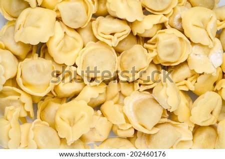 Home made fresh pasta, italian tortellini - stock photo