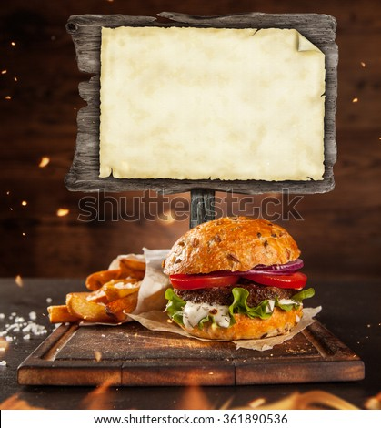 Home made hamburger with blank blackboard - stock photo
