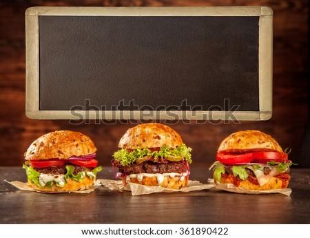 Home made hamburgers with blank blackboard - stock photo