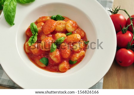 Home made italian gnocchi with tomato sauce and basil - stock photo