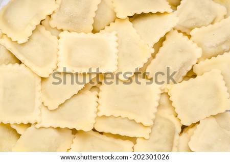 Home made italian pasta, ravioli - stock photo