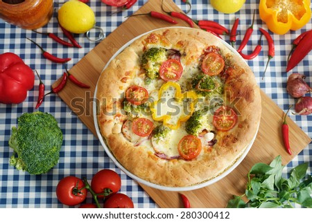 Home made margarita pizza and vegetable background. - stock photo