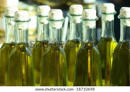 Home-made olive oil in bottles on a market