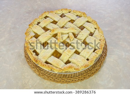 home made peach pie with lattice top and pi sign - stock photo