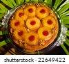 home made pineapple upside down cake with walnuts and cherries - stock photo